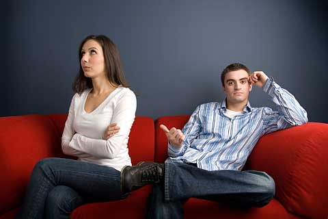 Quarreling couple, blaming each other